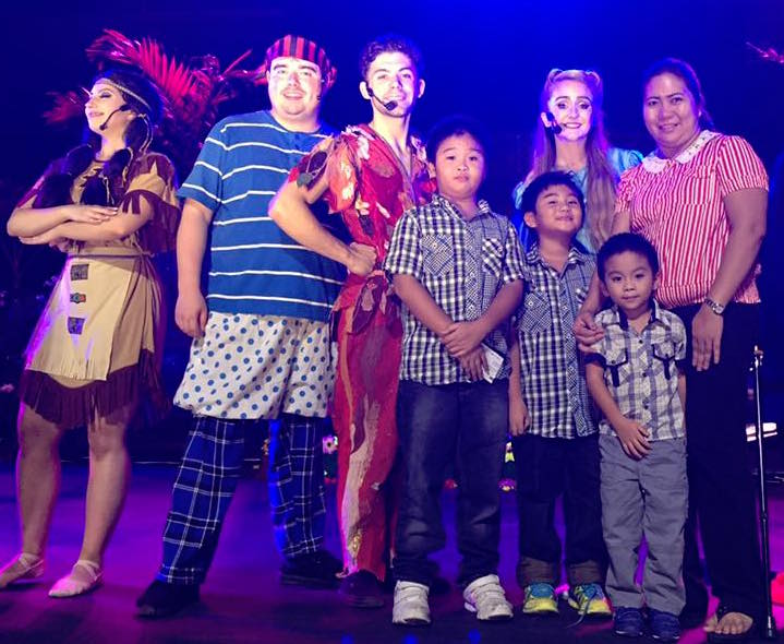 The cast of Peter Pan the Musical Adventure poses for photos with the audience after the show.
