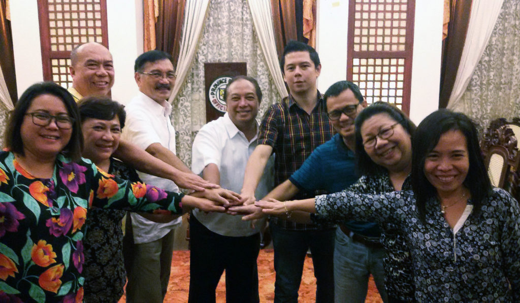 """Tripartite partners strike an """"all of one, one for all"""" pose to symbolize a solid partnership."""